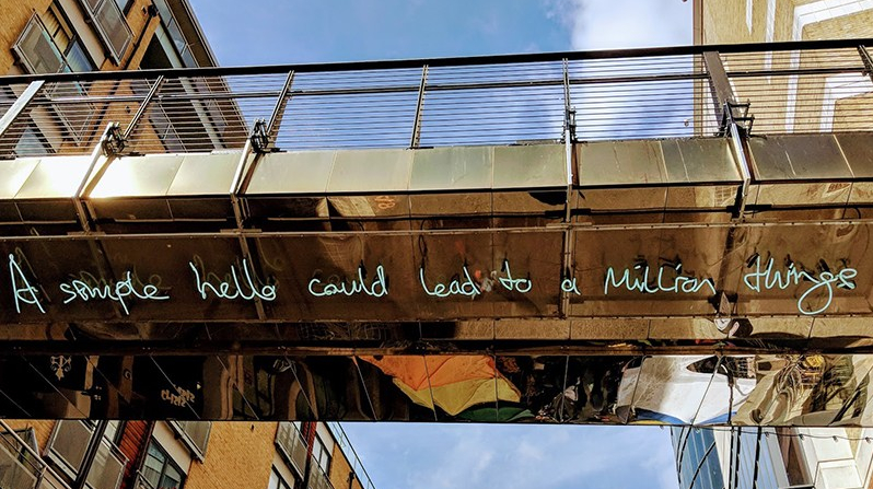 Neon street art: on Surrey Street footbridge